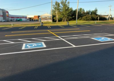 parking lot paving done and disability sign painted